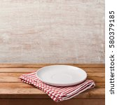 empty white plate on wooden... | Shutterstock . vector #580379185