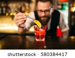 Stock photo bartender making alcohol coctail in restaurant 580384417