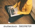 the young woman is sitting on... | Shutterstock . vector #580398709