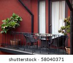 table and armchair at out door balcony - stock photo