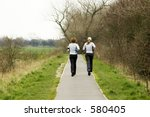 two joggers on country path | Shutterstock . vector #580405