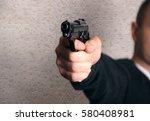 gun in the hand   Shutterstock . vector #580408981