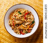 udon stir fry noodles with... | Shutterstock . vector #580411855