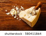 parmesan cheese on wooden board ... | Shutterstock . vector #580411864