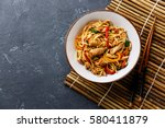 udon stir fry noodles with... | Shutterstock . vector #580411879