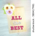Small photo of ALL THE BEST words on the wooden background vintage retro or rustic style with flowers