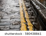 wet cobbled road | Shutterstock . vector #580438861