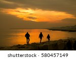 a family of three walking on a... | Shutterstock . vector #580457149