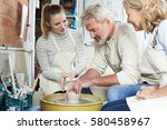 mature couple with teacher in... | Shutterstock . vector #580458967