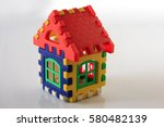 colorful toy house on white...