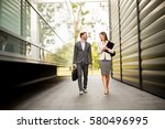 young business couple walking... | Shutterstock . vector #580496995