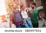happy group of tourists... | Shutterstock . vector #580497031