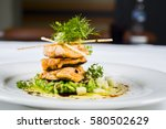 Small photo of Fine dining, fish fillet breaded in herbs and spice on vegetable risotto.