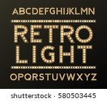 alphabet with bulb lamps gold... | Shutterstock .eps vector #580503445