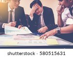 three business people serious... | Shutterstock . vector #580515631