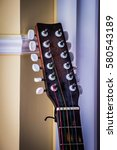 Small photo of Guitar headstock on wall background