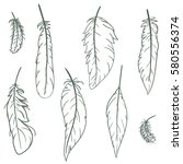 set of hand drawn feathers on... | Shutterstock .eps vector #580556374
