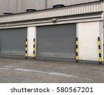 factory shutter door is closed | Shutterstock . vector #580567201