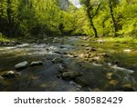 river flowing through freshly... | Shutterstock . vector #580582429