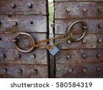 mighty old metal gate locked... | Shutterstock . vector #580584319