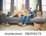 couple sitting on the couch and ... | Shutterstock . vector #580590175