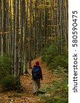 woman hiking along a mountain... | Shutterstock . vector #580590475