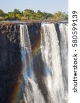 Small photo of Incredible rainbow in the spray from the Victoria Falls, Zimbabwe