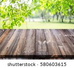 empty wooden table with garden... | Shutterstock . vector #580603615