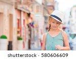 adorable happy little girl... | Shutterstock . vector #580606609