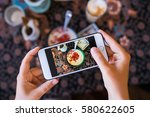 hands with the phone close up... | Shutterstock . vector #580622605