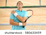 shot of a tennis player with a...   Shutterstock . vector #580633459