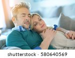 middle aged couple relaxing... | Shutterstock . vector #580640569