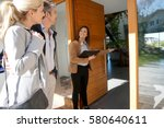 real estate agent inviting... | Shutterstock . vector #580640611