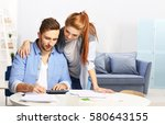 young couple calculating taxes... | Shutterstock . vector #580643155