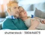 middle aged couple relaxing... | Shutterstock . vector #580646875
