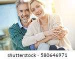 cheerful middle aged couple... | Shutterstock . vector #580646971
