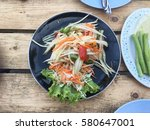 thai papaya salad  som tum from ... | Shutterstock . vector #580647001
