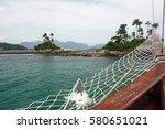 Small photo of ILHA BOTINAS, ANGRA DO REIS, RIO DE JANEIRO, BRAZIL - APRIL 9, 2011: Sailing in green and clear waters aboard a sailboat bound for the Botinas Island