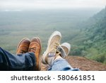 legs of couple traveler sitting ... | Shutterstock . vector #580661851