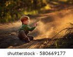 cute red haired boy is playing... | Shutterstock . vector #580669177