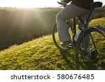Closeup Of Cyclist Man Legs An...