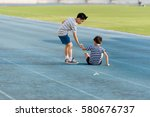 young asian boy running on blue ... | Shutterstock . vector #580676737
