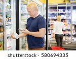 man scanning bar code on... | Shutterstock . vector #580694335
