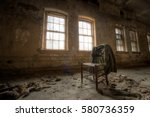 old chair and suit jacket... | Shutterstock . vector #580736359