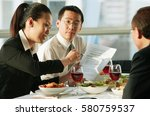 executives having lunch meeting | Shutterstock . vector #580759537