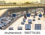 heavy traffic on the highway | Shutterstock . vector #580776181