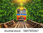 Train Running In Tree Tunnel On ...