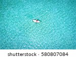woman on a stand up paddle boat ... | Shutterstock . vector #580807084