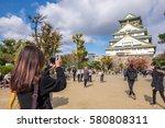 woman travel to osaka castle... | Shutterstock . vector #580808311