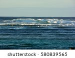 surfers waiting in front of... | Shutterstock . vector #580839565